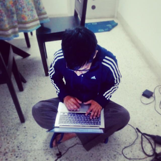 Thejesh GN sitting on floor