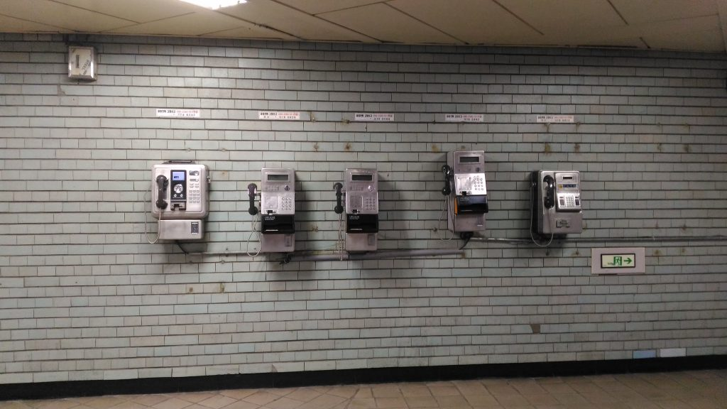 Plain Old Telephones inside a metro station.