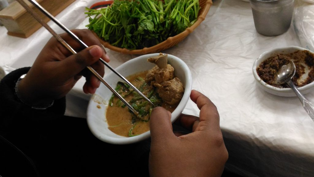 You serve yourself and into a small dish to eat. I used my hands but most people use chop sticks.