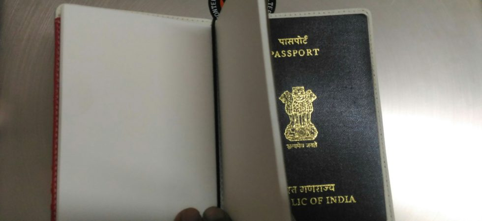 Attaching the notebook to passport holder is easy using an elastic band.